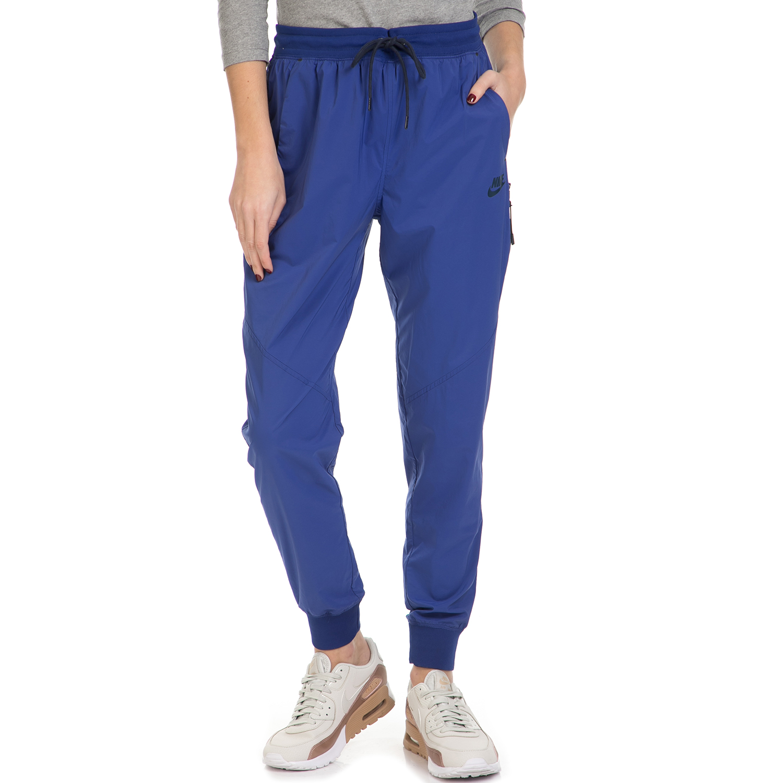 NIKE - Γυναικεία φόρμα NIKE BONDED WOVEN PANT μπλε γυναικεία ρούχα αθλητικά φόρμες
